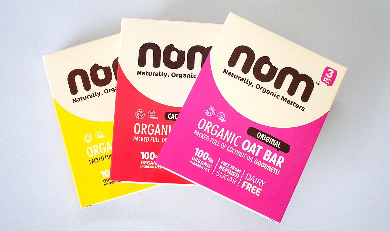 Nom foods brand id by wetdog creative for Food bar packaging